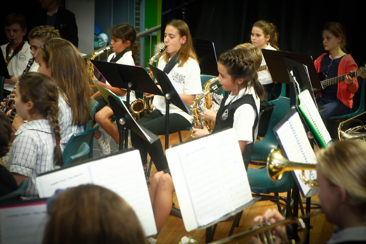 Students playing their instruments in the school band